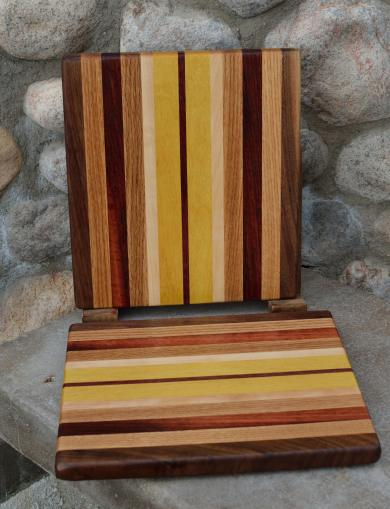 "Cheese Board # 15 - 029. Black Walnut, Red Oak, Padauk, Hard Maple and Yellowheart. Edge Grain. 8"" x 11"" x 3/4""."