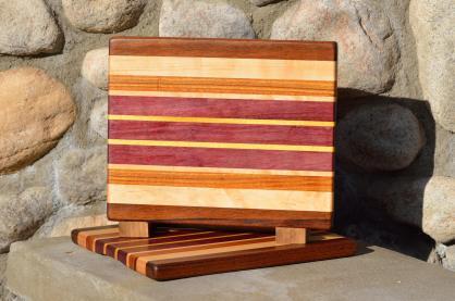 "Cheese Board # 15 - 040. Jatoba, Hard Maple, Canarywood, Purpleheart & Yellowheart. Edge grain. 11-1/2"" x 9-1/4"" x 3/4""."
