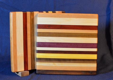 "Cheese Board # 15 - 048. Cherry, Hard Maple, Jatoba, Honey Locust, Jatoba, Purpleheart, Black Walnut & Yellowheart. 9"" x 11"" x 3/4""."