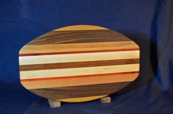 "Surfboard # 15 - 27. Cherry, Black Walnut, Padauk, Hard Maple and Jatoba. 12"" x 19"" x 1-1/4"". Sold in its first showing."