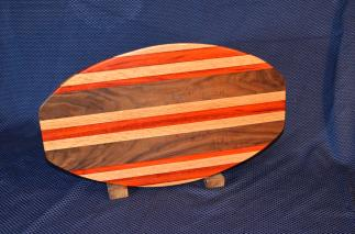 "Surfboard # 15 - 29. Red Oak, Padauk & Black Walnut. 12"" x 19"" x 1-1/4""."
