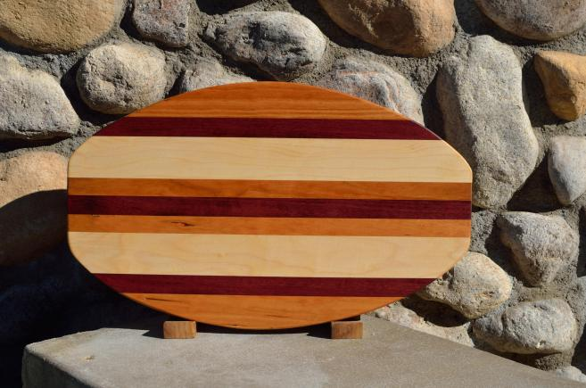 "Surfboard # 15 - 35. Cherry, Purpleheart & Hard Maple. 12"" x 19"" x 1-1/4""."