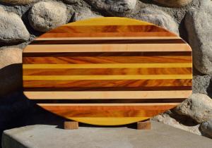 "Surfboard # 15 - 37. Yellowheart, Canarywood, Cherry, Hard Maple & Black Walnut. 12"" x 19"" x 1-1/4""."