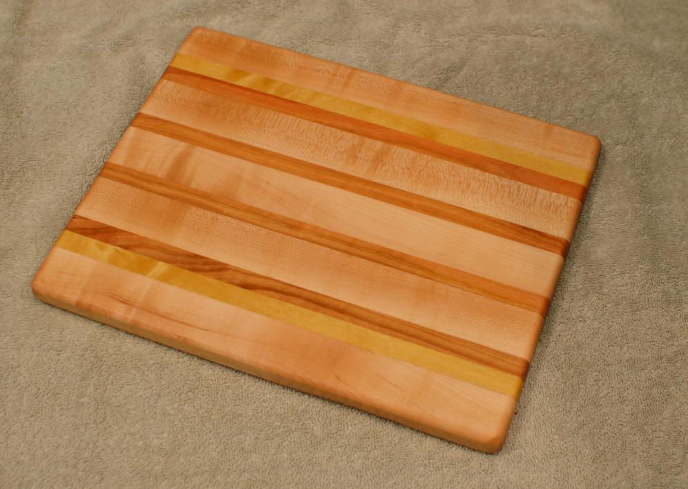 "Cheese Board 15 - 058. Hard Maple, Yellowheart & Cherry. 8"" x 11"" x 3/4""."
