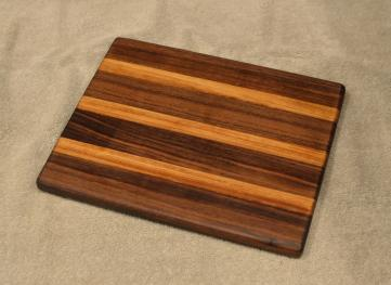 "Cheese Board # 15 - 065. Black Walnut & Teak. 8"" x 11"" x 3/4""."