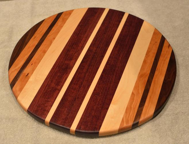 "Lazy Susan # 15 - 038. Black Walnut, Cherry, Hard Maple & Purpleheart. 17"" diameter x 3/4""."