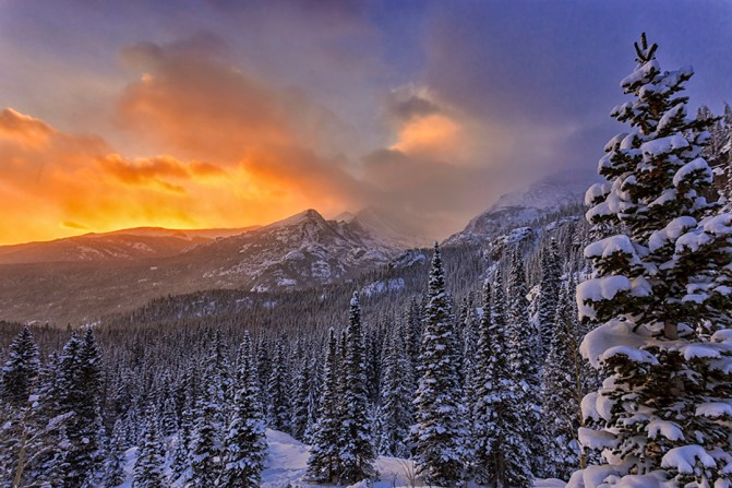 "Eric Schuette loves taking photos of Rocky Mountain National Park in Colorado. Every trip into the park can be a special moment. ""The mountains were completely covered by clouds. As we hiked into the darkness you could see little signs of clearing and then just before the sun came up the clouds thinned and we were left with a beautiful winter scene looking out towards Long's Peak."" Photo by Eric Schuette. Posted on Tumblr by the US Department of the Interior, 12/21/15."