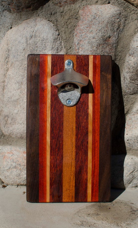 "Bottle Opener 15 - 02. Black Walnut, Padauk, Cherry, Jarrah & Jatoba. 5"" x 10"" x 3/4"". Magic Bottle Opener."