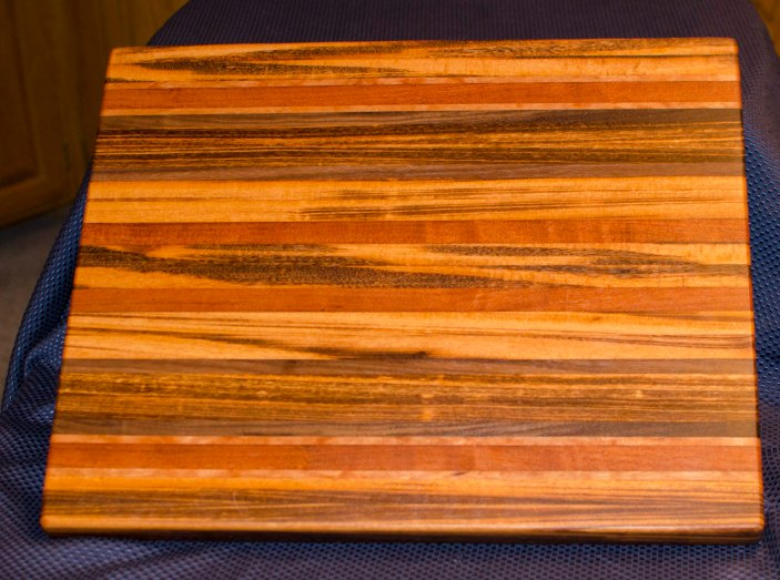 "Cutting Board 16 - Edge 003. Goncalo Alves, Jatoba, Black Walnut, Cherry. Edge Grain. 17"" x 21"" x 1-1/2"". Commissioned piece."