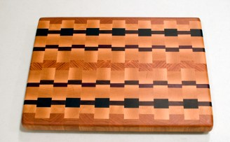 "Cutting Board 16 - End 009. Cherry, Hard Maple, Jatoba, Padauk, Purpleheart, Honey Locust & Bloodwood. End grain. 11"" x 15"" x 1-3/8""."