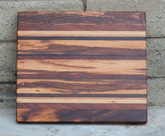 "Cutting Board 16 - Edge 003. Black Walnut, Jatoba, Honey Locust, Goncalo Alves & Cherry. 15"" x 17"" x 1-3/8""."