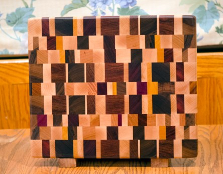 "Cutting Board 16 - End 022. Chaos board. Hard Maple, Cherry, Padauk, Jatoba, Purpleheart, Yellowheart, Goncalo Alves, Honey Locust & Black Walnut. End grain. 12"" x 14"" x 1-1/4""."