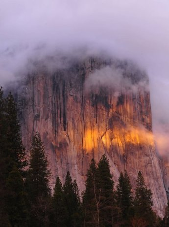 Sunset and fog create this dramatic pic at Yosemite National Park. El Capitan is nearly shrowded on this stormy day, but is glowing in sunset's sweet light. Photo by Christine White Loberg, National Park Service. Tweeted by the US Department of the Interior, 3/6/16.