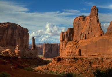 The massive sandstone monoliths along Park Avenue Trail at Arches National Park in Utah have imaginative and descriptive names. You won't regret this easy one-mile hike. Where else can you walk in the shadows of the Tower of Babel, the Organ, the Three Gossips and Sheep Rock? Photo by Bud Walley. Posted on Tumblr by the US Department of the Interior, 4/5/16.