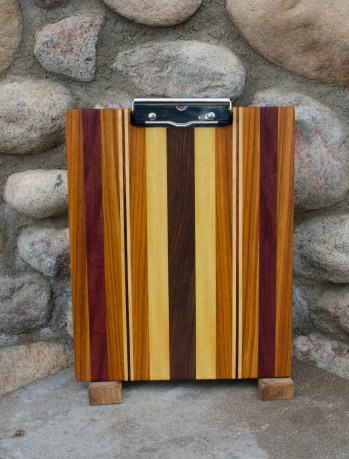 "Clipboard 16 - 008. Black Walnut, Canarywood, Yellowheart & Purpleheart. Letter size. 1/2"" capacity clip."