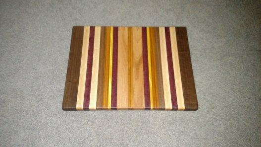 "Cutting Board 16 - Edge 006. Edge grain. Black Walnut, Hard Maple, Bloodwood, Canarywood & Yellowheart. 13-1/2"" x 18"" x 1-1/4""."