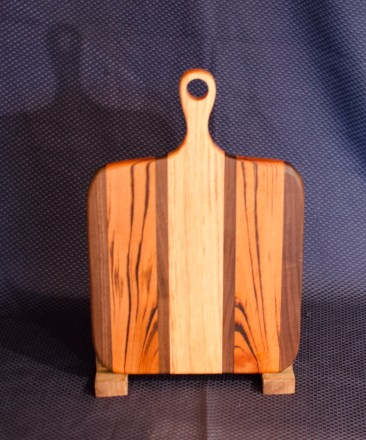 "Sous Chef 16 - 011. Black Walnut, Goncalo Alves (AKA Tigerwood) & Honey Locust. 9"" x 12"" work surface & 4"" handle."