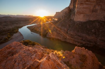 Sunrise, as seen from the mouth of the Santa Elena Canyon in Big Bend National Park in Texas. An explorer's paradise, Big Bend is a great place to paddle, hike and marvel at the 1,500 foot tall cliff walls. There's also world class bird watching this time of year because of the park's diverse set of ecosystems. Photo by Howard Lawrence. Posted on Tumblr by the US Department of the Interior, 5/24/16.