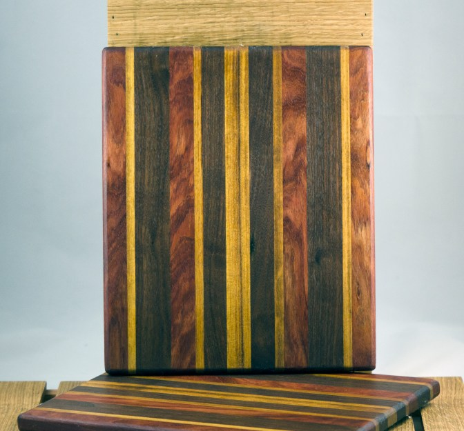 "Cheese Board 16 - 017. Bubinga, African Teak & Black Walnut. 8"" x 11"" x 3/4""."