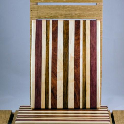 "Cheese Board 16 - 018. Hard Maple, Purpleheart, Jatoba & Bloodwood. 9"" x 11"" x 3/4""."