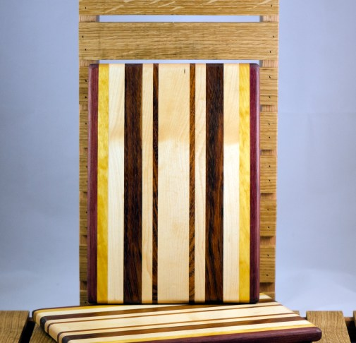 "Cheese Board 16 - 020. Purpleheart, Yellowheart, Black Walnut, Hard Maple & Jatoba. 7"" x 11"" x 3/4""."