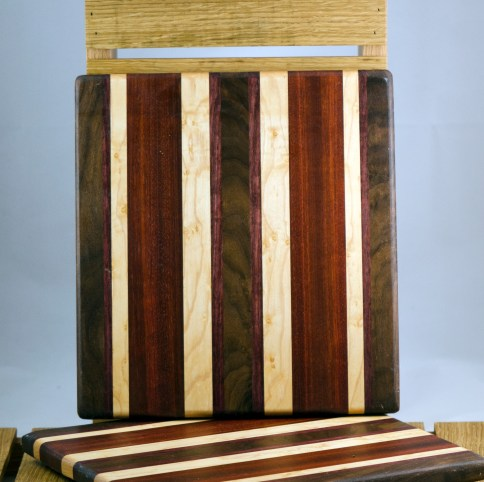 "Cheese Board 16 - 022. Black Walnut, Bubinga, Bloodwood & Birdseye Maple. 9"" x 11"" x 3/4""."