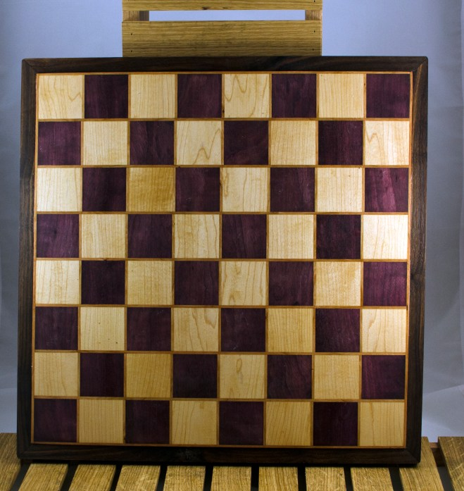 """Chess 16 - 06. Playing surface is Purpleheart & Hard Maple, with the squares framed in Cherry. Board is framed in Black Walnut. Squares are 2-1/8"""" across."""