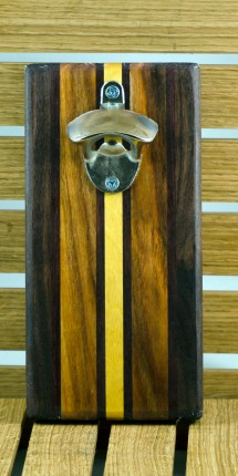 """Magic Bottle Opener 16 - 075. Black Walnut, Canarywood & Yellowheart. Double magic, so it will mount to your attractive refrigerator. Approximately 5"""" x 10"""" x 3/4""""."""