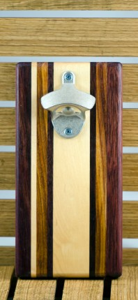 "Magic Bottle Opener 16 - 082. Wall mount. Purpleheart, Hard Maple, Canarywood & Black Walnut. Approximately 5"" x 10"" x 3/4""."