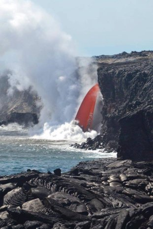 """A so-called """"firehose"""" of lava pouring into the ocean at Hawaii Volcanoes National Park. Tweeted by the US Department of the Interior, 1/30/17."""
