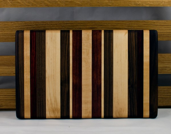 """Small Board 16 - 018. Black Walnut, Hard Maple & Bloodwood. 8"""" x 12"""" x 1"""". This board had an end drilled through ... so I had to cut off both ends and re-glue new, matching boards to keep the board's symmetry."""