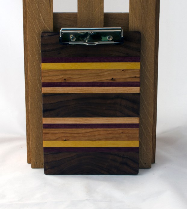 "Clipboard 16 - 022. Black Walnut, Purpleheart, Yellowheart, Cherry & Hard Maple. Note pad size. 1/2"" clip."