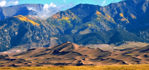 From mountains to sand dunes to wetlands, Great Sand Dunes National Park & Preserve in Colorado has a terrific diversity of ecosystems. Each landscape is affected differently by the seasons. With fall descending on the park, that means patches of aspens in the alpine ranges are starting to show their gorgeous yellow colors. What a view! Photo by Patrick Myers, National Park Service. Posted on Tumblr by the US Department of the Interior, 10/11/16.