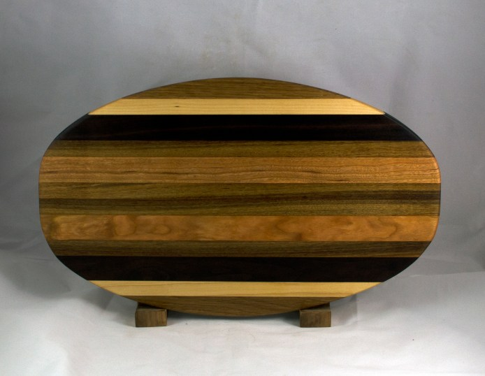 "Cheese & Cracker Server 16 - 08. White Oak, Hard Maple, Black Walnut & African Teak. 12"" x 19"" x 1-1/4""."