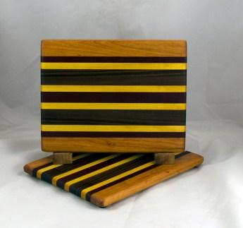"""Cheese Board 16 - 061. Cherry, Padauk, Yellowheart & Black Walnut. 8"""" x 11"""" x 3/4""""."""