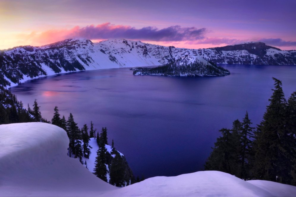Sunset glows purple over snow at Crater Lake National Park. Photo by John Dale. Tweeted by the US Department of the Interior, 12/4/16.