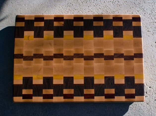 "Cutting Board 16 - End 051. Hard Maple, Black Walnut, Yellowheart, Padauk & Jatoba. End Grain. 16"" x 21"" x 1-1/2"". Purchased out of the shop before it was finished."