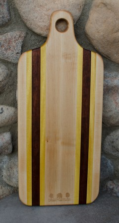 "Engraved 16 - 49. Bread board made for Urban Tree Care. Hard Maple, Yellowheart and Bubinga. 8"" x 20"" x 1""."