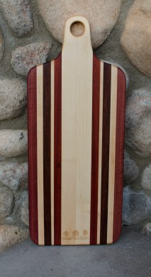 "Engraved 16 - 51. Bread board made for Urban Tree Care. Hard Maple, Purpleheart, Bloodwood and Bubinga. 8"" x 20"" x 1""."