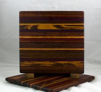 "Cheese Board 17 - 318. Jatoba, Purpleheart, Cherry, Goncalo Alves & Bloodwood. Chaos Board. 11-1/4"" x 11-1/2"" x 1/2""."