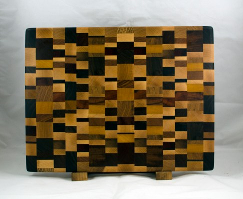 "Cutting Board 17 - 411. Chaos Board, End Grain. Black Walnut, Hard Maple, Cherry, White Oak, Purpleheart, Jatoba, Hickory, Goncalo Alves, Yellowheart & Canarywood. 13-1/2"" x 17-3/4"" x 1-1/4""."