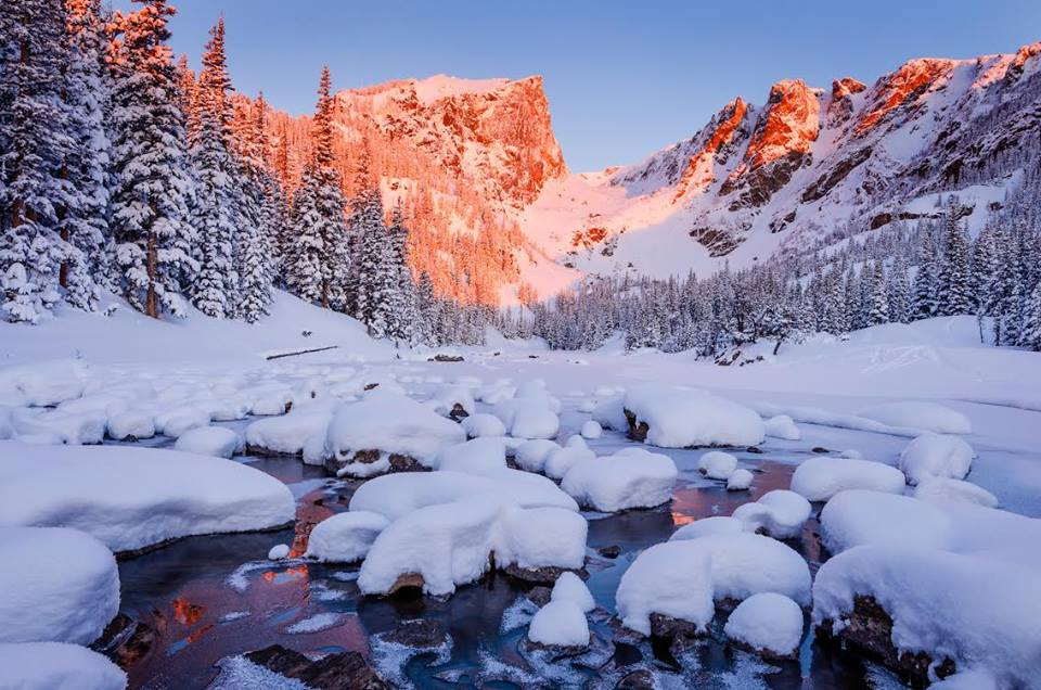 Even in cold weather, you can explore the Rocky Mountain National Park's spectacular mountain environments by snowshoeing, cross-country skiing, sledding and wildlife watching. In fact, winter is an especially good time to look for elk, mule deer, moose and other large mammals. Sunrise photo of Dream Lake in 2014 by C. Brindle, National Park Service. Tweeted by the US Department of the Interior, 1/17/17.