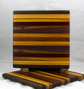 "Small Board 17 - 213. Black Walnut, Cherry, Yellowheart, Canarywood, Padauk, Caribbean Rosewood, Purpleheart & Jatoba. 11-1/4"" x 11-1/2"" x 3/4""."