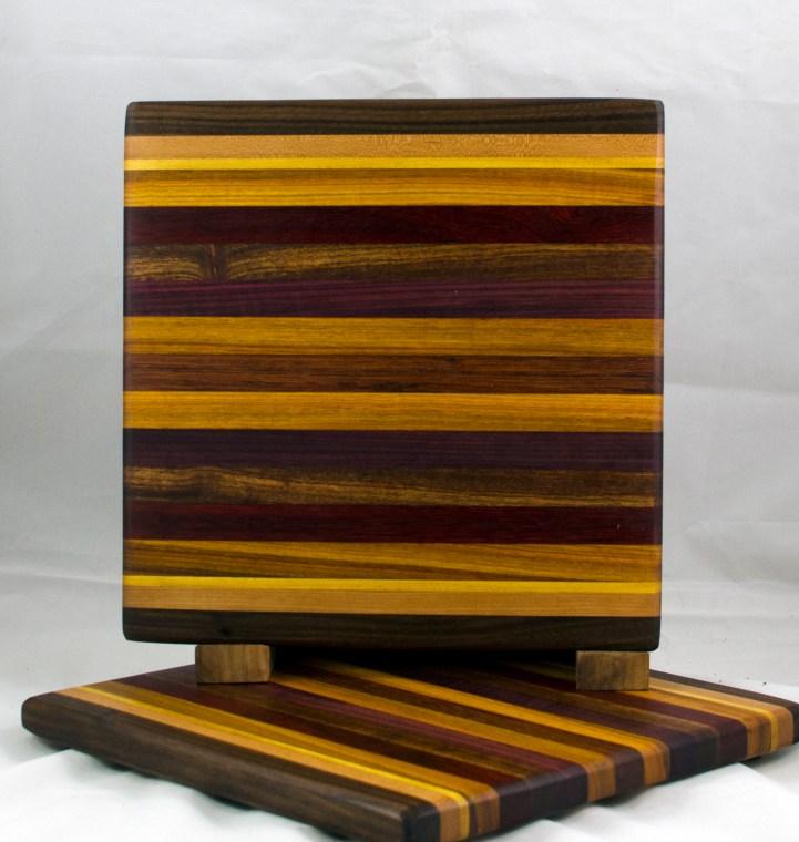 """Small Board 17 - 213. Black Walnut, Cherry, Yellowheart, Canarywood, Padauk, Caribbean Rosewood, Purpleheart & Jatoba. 11-1/4"""" x 11-1/2"""" x 3/4""""."""