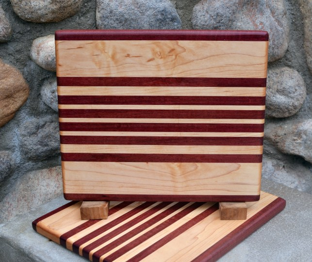 "Cheese Board 17 - 323. Purpleheart & Hard Maple. 9"" x 11"" x 3/4""."