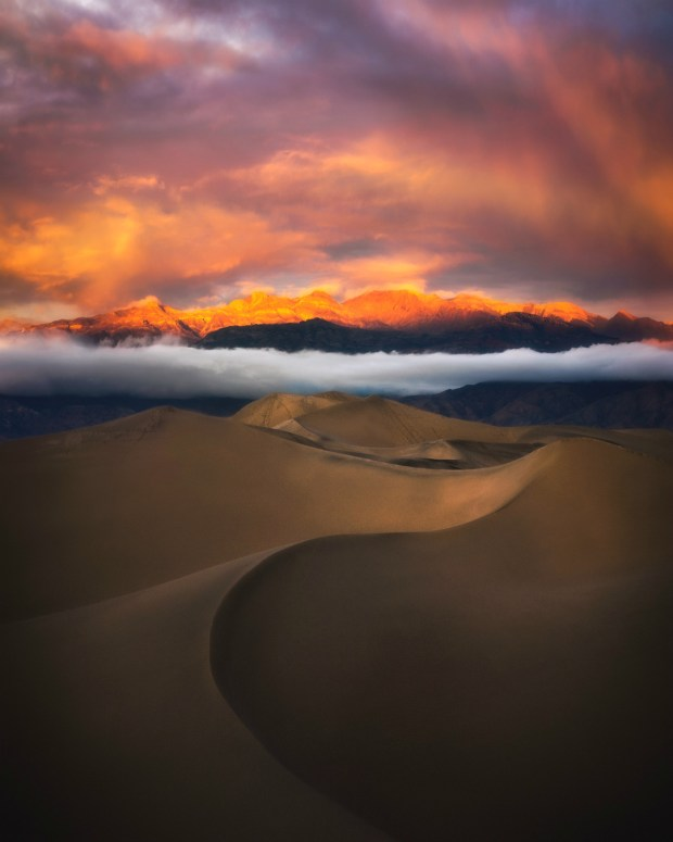 Sunset at Death Valley National Park in California is a magical time. The retreating sun mutes the shadowed ripples and graceful curves of the sand dunes while the day's last light focuses on the mountaintops. Here, a rogue white cloud wanders in to enjoy the view. Photo courtesy of Sandra Slead. Posted on Tumblr by the US Department of the Interior, 3/4/17.