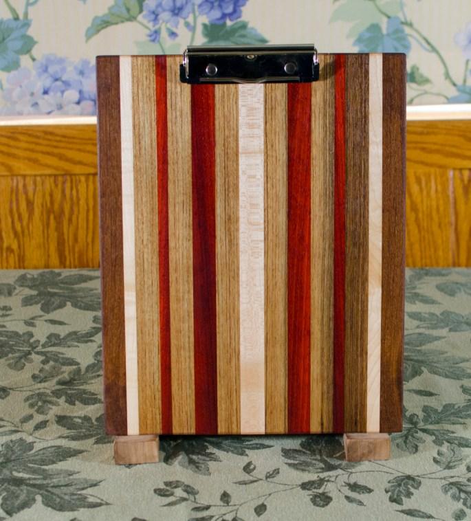 "Clipboard 17 - 001. Jatoba, Hard Maple, Red Oak & Padauk. Letter size with a 1/2"" clip."
