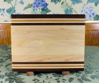 "Cutting Board 17 - 117. Black Walnut, Hard Maple and Cherry. Edge grain. 12"" x 16"" x 1-1/4""."