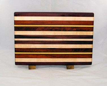 "Cutting Board 17 - 118. Purpleheart, Hard Maple, Padauk, Yellowheart & Black Walnut. Edge Grain. 11"" x 15"" x 1-1/8""."