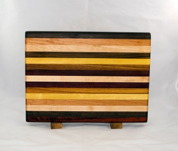 "Cutting Board 17 - 120. Purpleheart, Cherry, Hard Maple, Yellowheart, Canarywood, Bubinga & Padauk. Chaos Board. Edge Grain. 12"" x 16"" x 1-1/8""."